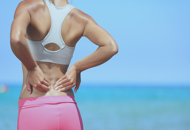 Back Pain Athletic Woman Rubbing Her Back