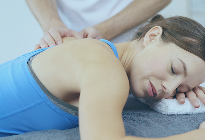 Woman Having A Massage On Her Injured Upper Back