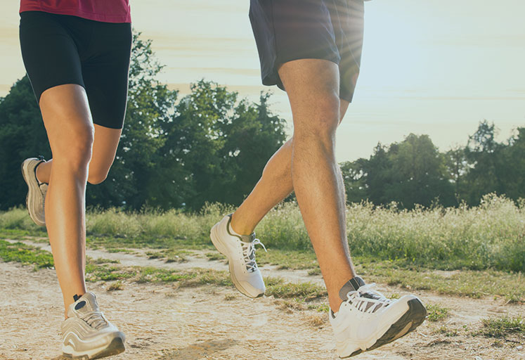 Young Couple Jogging In Park